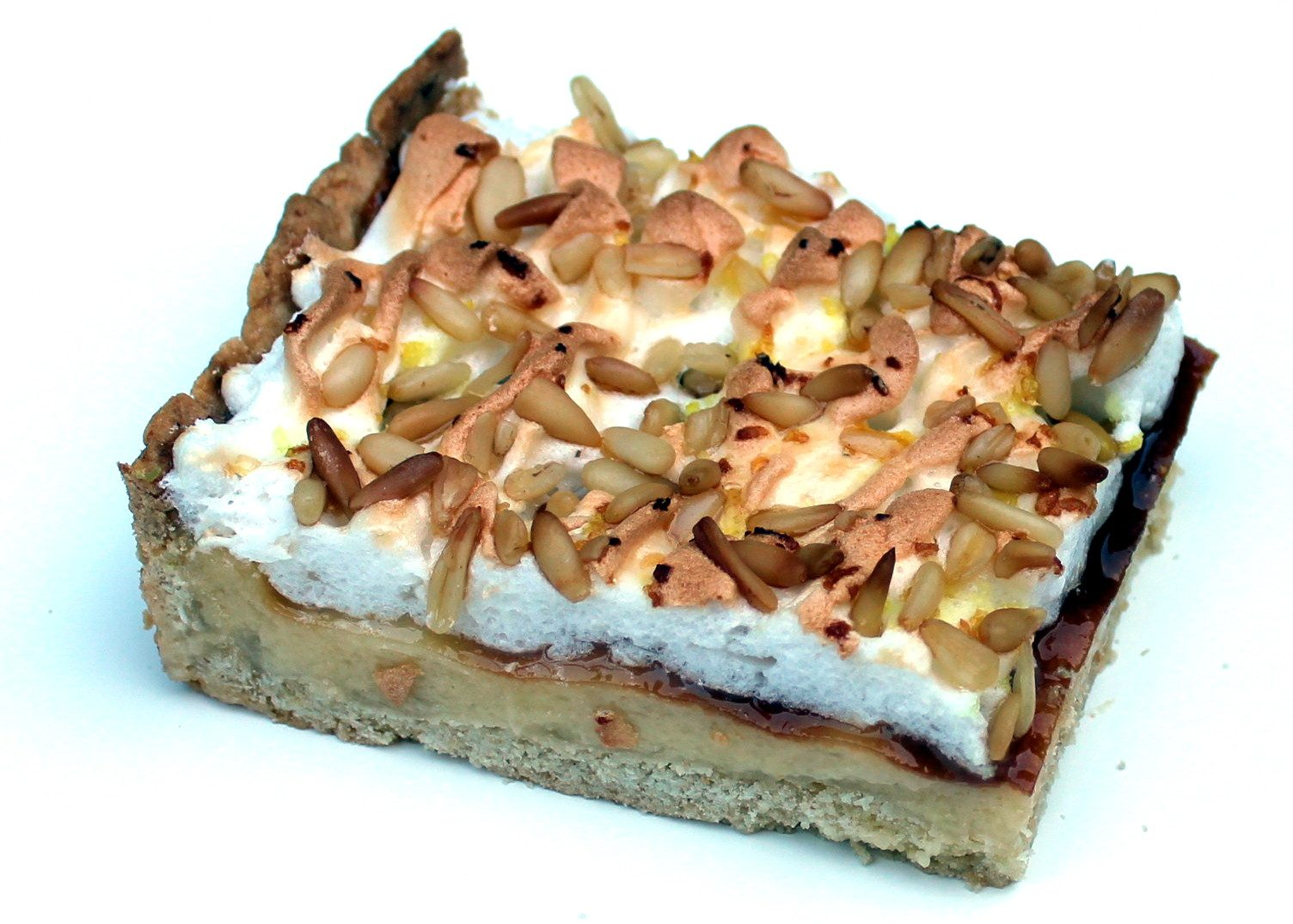 Tarta de crema y piñones