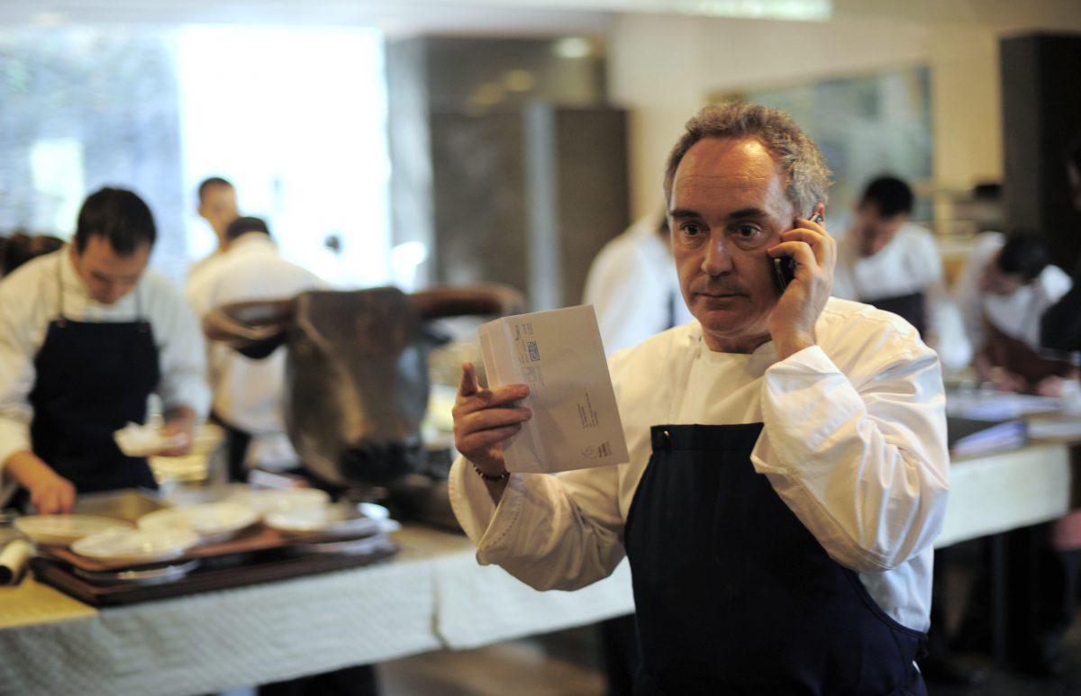 Ferran Adria speaks on the phone in his restaurant elBulli
